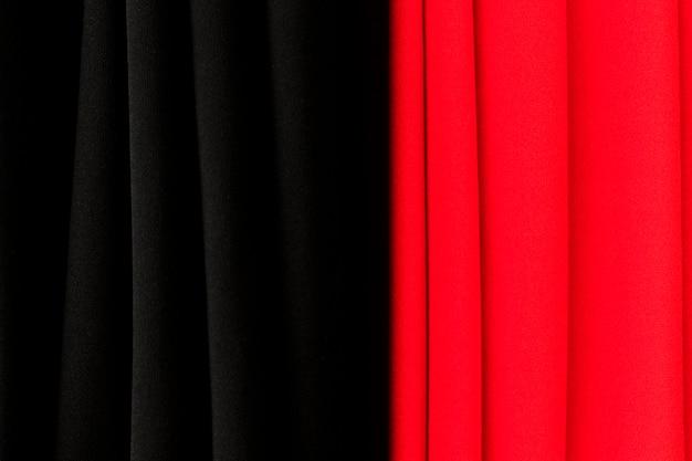 Rode en zwarte gordijn textuur achtergrond