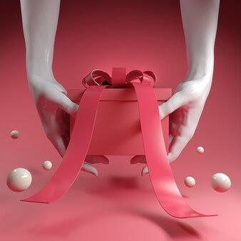 Rode geschenkdoos met strik in hand in hand