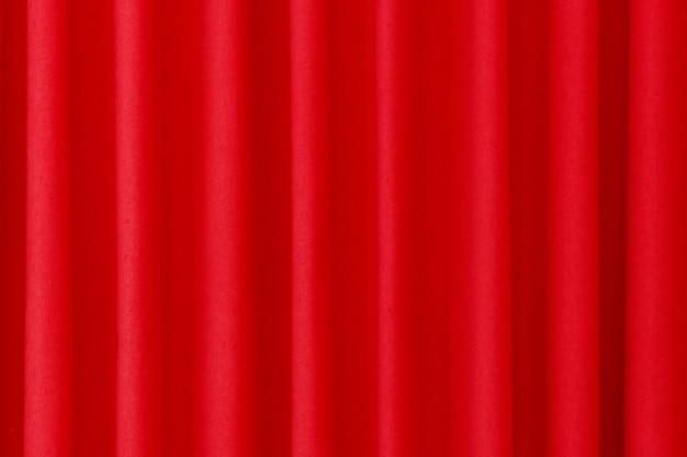 Rode gesloten gordijn achtergrond extreme close-up.