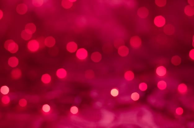 Rode kerstmisachtergrond van de bokehtextuur