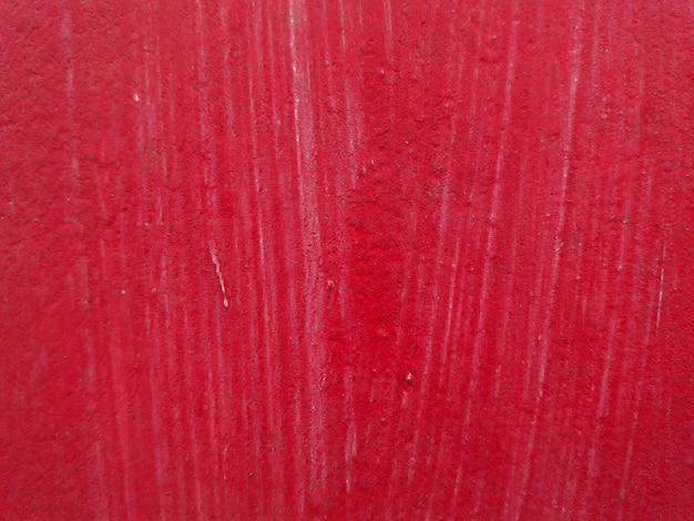 Rode kleur muur achtergrond met grunge abstracte aard textuur