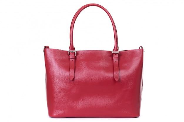 Rode lederen handgemaakte tas op een wit