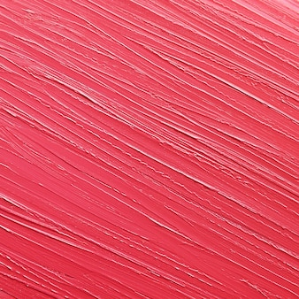 Rode lippenstift textuur, lipgloss close-up. schoonheid industrie concept.