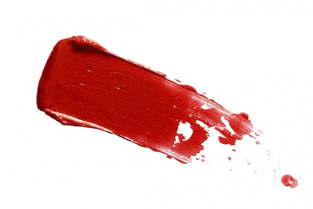 Rode lippenstiftvlek die op wit wordt geïsoleerd