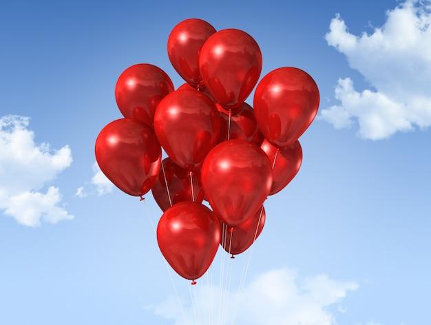 Rode luchtballons die op een blauwe hemel drijven
