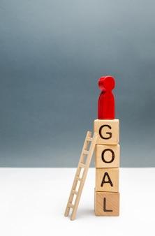 Rode man staat op een toren met het woord doel
