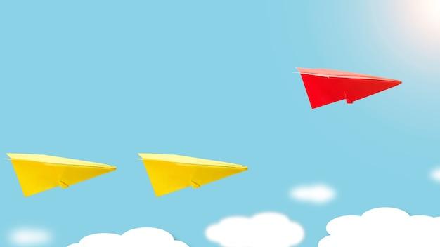 Rode origami papieren vliegtuig vliegt over het gele vliegtuig concept van leiderschap