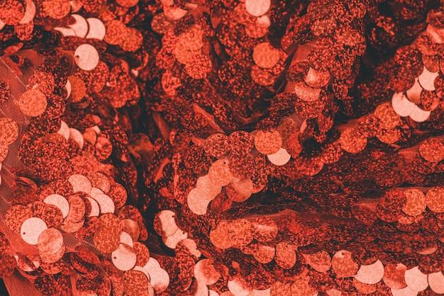 Rode pailletten textiel achtergrond. glitter stof. rode achtergrond