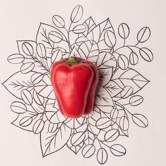 Rode paprika over overzichts bloemenachtergrond