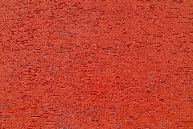 Rode pleistermuur van een gebouw. ruwe oppervlaktestructuur.