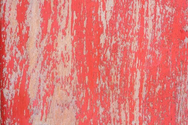 Rode rustieke teruggewonnen houten muur.
