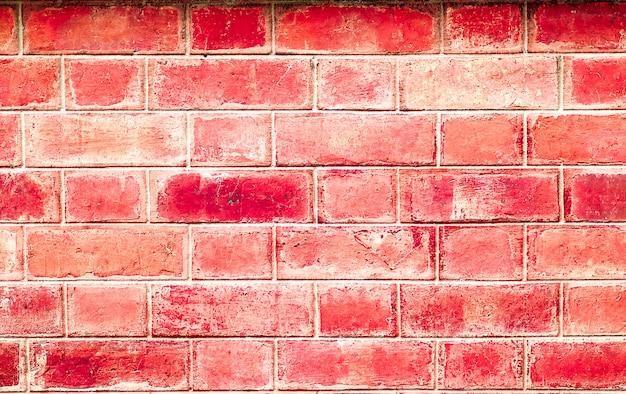 Rode ruwe bakstenen muur voor textuur of achtergrond.