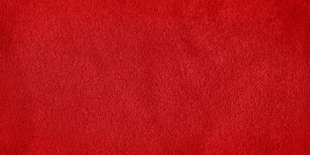 Rode suède lederen textuur. macro foto van een rode fluwelen textuur.