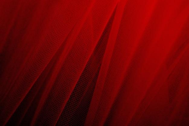 Rode tule draperie getextureerde achtergrond