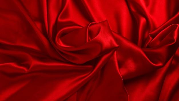 Rode zijde of satijn luxe stof textuur achtergrond. bovenaanzicht.