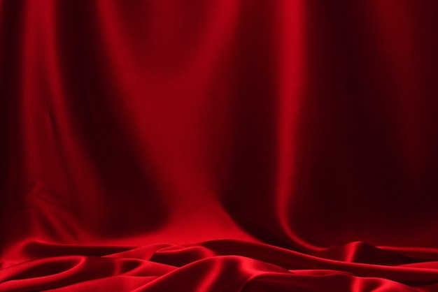 Rode zijde of satijn luxe stof textuur achtergrond.