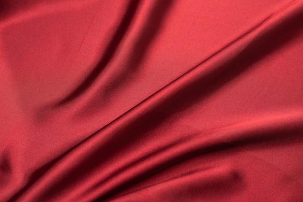 Rode zijde of satijn luxe stof textuur. bovenaanzicht