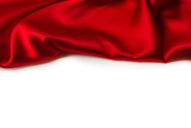 Rode zijde of satijn luxe stof textuur kan als abstract worden gebruikt.
