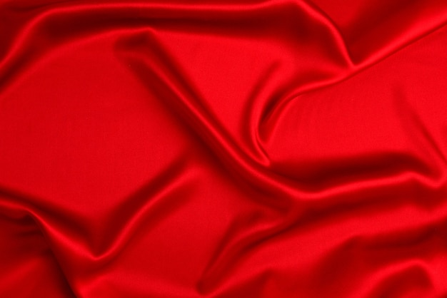 Rode zijde of satijn luxe stof textuur kan als abstracte achtergrond gebruiken