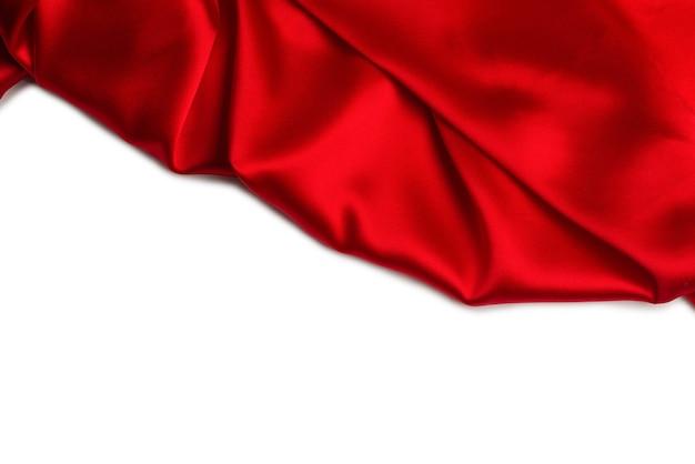 Rode zijde of satijn luxe stoffentextuur kan als abstracte muur worden gebruikt. bovenaanzicht.