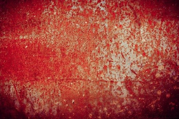 Roestig metalen oppervlak bedekt met gebarsten verf