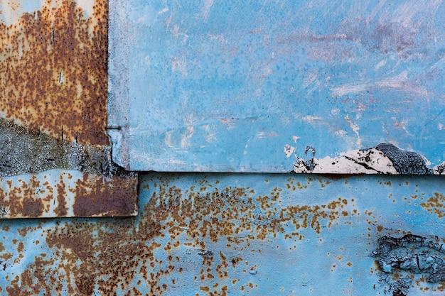 Roestige blauwe metalen achtergrond