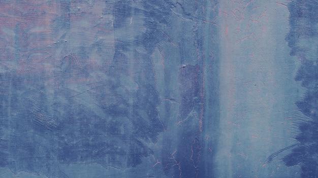 Roestige blauwe muur met verfachtergrond