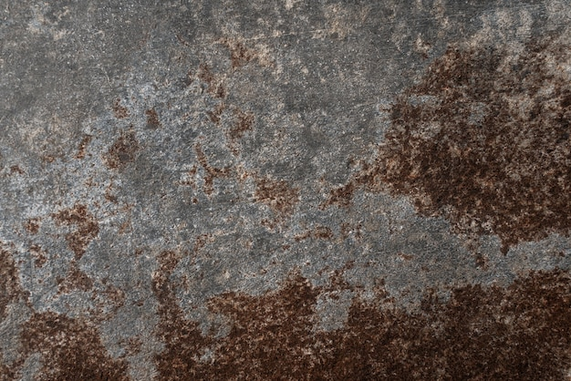 Roestige en beschadigde metalen achtergrond. elegante achtergrond of oud bord met vintage verontruste grungetextuur en donkergrijze houtskoolkleurverf