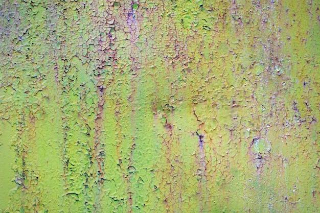 Roestige groene en blauwe ijzeren muur
