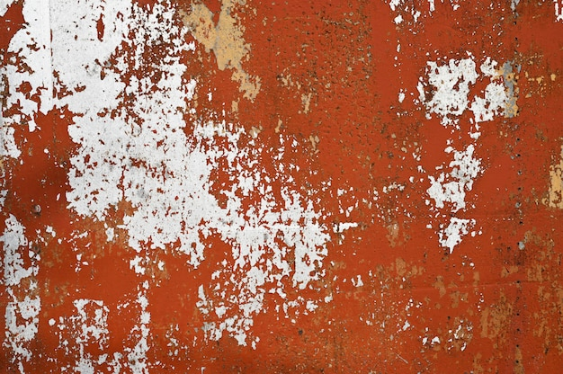 Roestige oranje metalen wand. achtergrond van oud metaal
