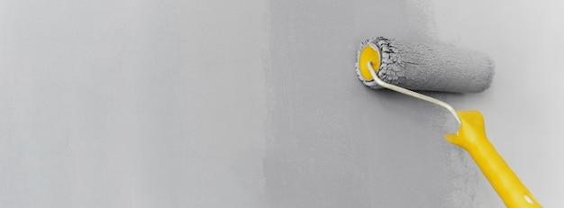 Roller schilderij grijze muur