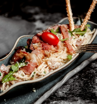 Romige spaghetti met champignons en ham