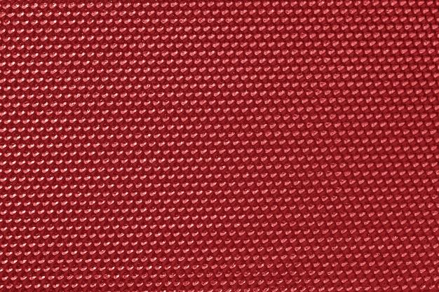 Rood gekleurd honingraatpatroon behang