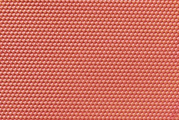 Rood gekleurde honingraatachtergrond