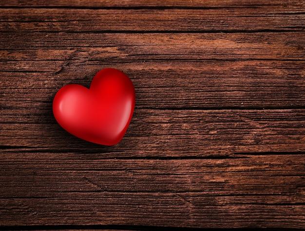 Rood hart op houten oppervlak