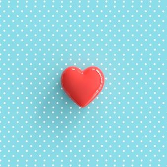 Rood hart op pokadot blauwe achtergrond. minimale valentijn concept idee.