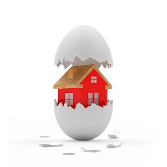Rood huisje in gebroken witte eierschaal