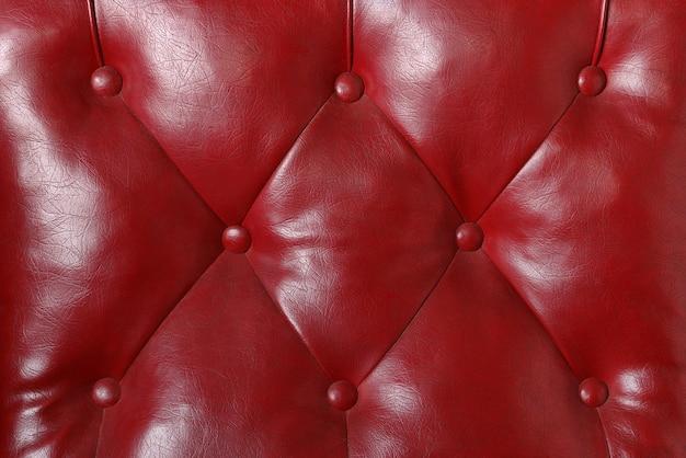 Rood leer op de achtergrond van de meubilairtextuur