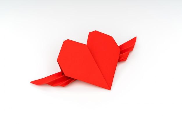 Rood papier origami hart met vleugels op een witte achtergrond.