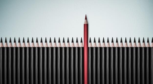 Rood potlood dat zich onderscheidt van de menigte van identieke zwarte kerels op witte tafel