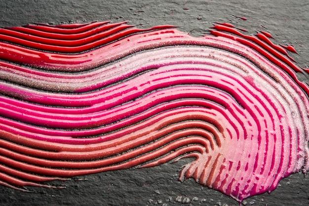 Roodoranje lipglosspakket en textuur
