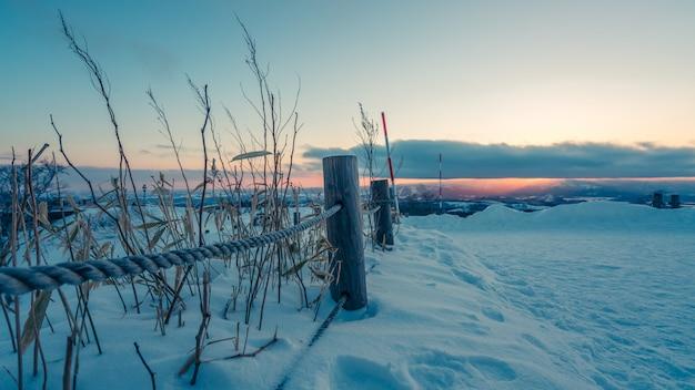 Rope fence met winter view