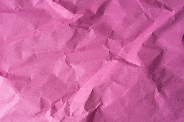Rose verfrommeld papier texturen bovenaanzicht, patroon kan worden gebruikt voor de achtergrond van tekst of inhoud. papieren achtergrond in hoge resolutie