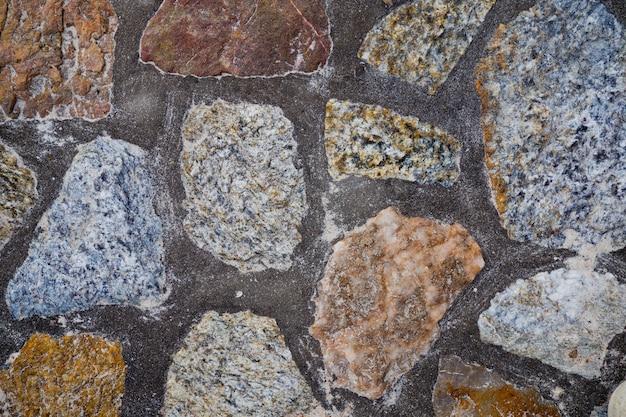 Rots achtergrondtextuur, muurachtergrond, steen