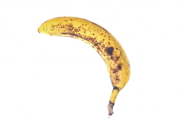 Rotte banaan met zwarte vlekken geïsoleerd