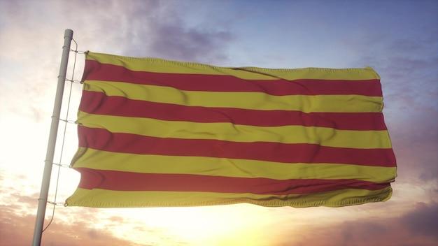 Roussillon vlag, frankrijk, zwaaien in de wind, lucht en zon achtergrond. 3d-rendering
