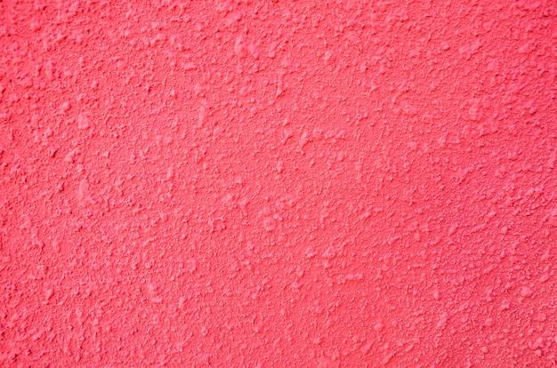 Roze achtergrond een deel van een gipsen muur als achtergrond