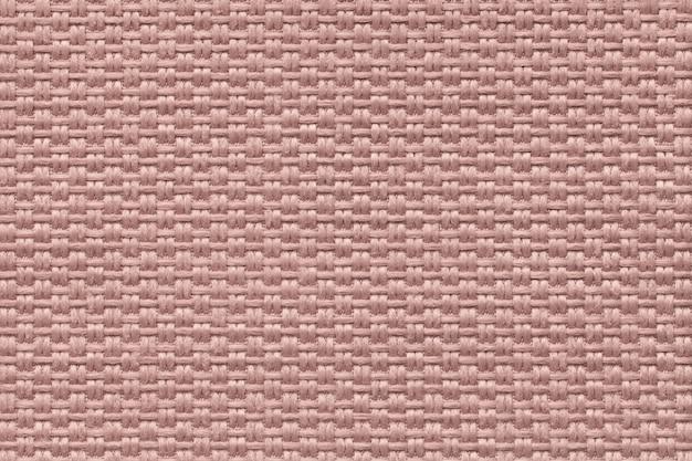 Roze achtergrond van dichte geweven in zakken doende stof, close-up. structuur van de textielmacro.