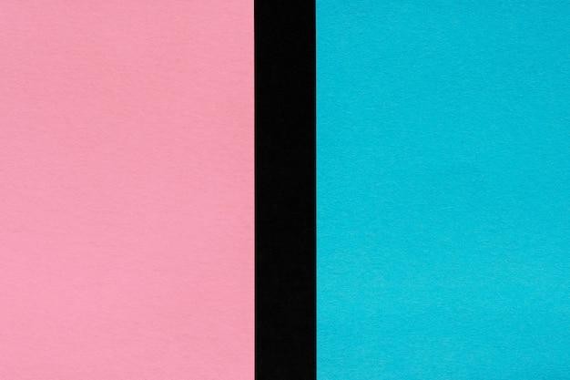 Roze en blauw papier op zwart, mockup