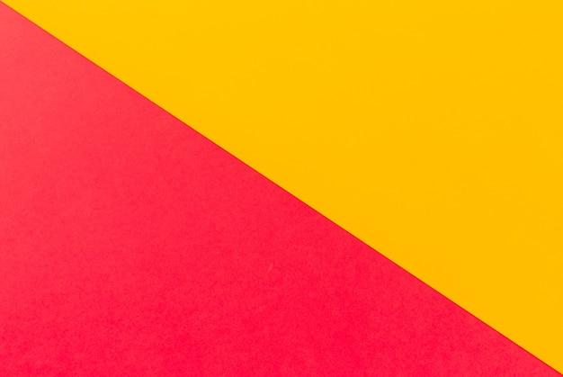 Roze en gele platte achtergrond
